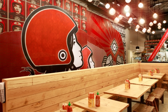 Above: The street view of Bun Mee, A Vietnamese restaurant designed in full by Simmons and his team.<br />Below: The interior complete with hand-painted mural.
