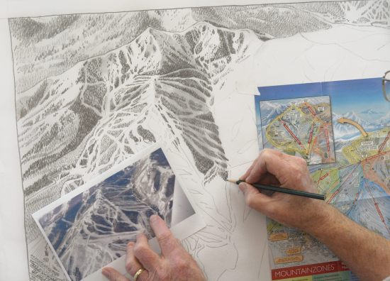 Niehues sketching out the map by pencil based on the image of the mountain.