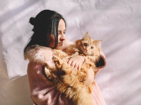Manuja Waldia shown hanging out with her cat.