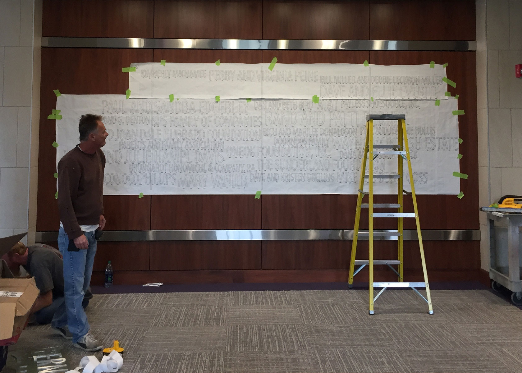 Michael Courtney prepares to display the type for the donor recognition wall at The Berney Family Welcome Center at Kansas State University.