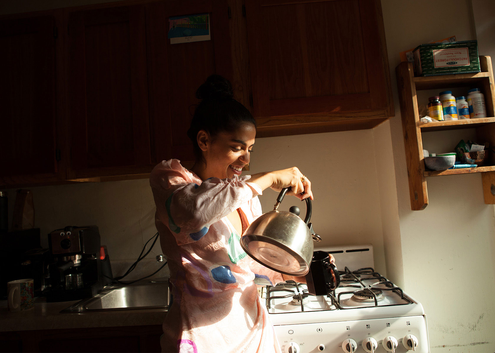 Mona Chalabi takes a tea break in her home kitchen.