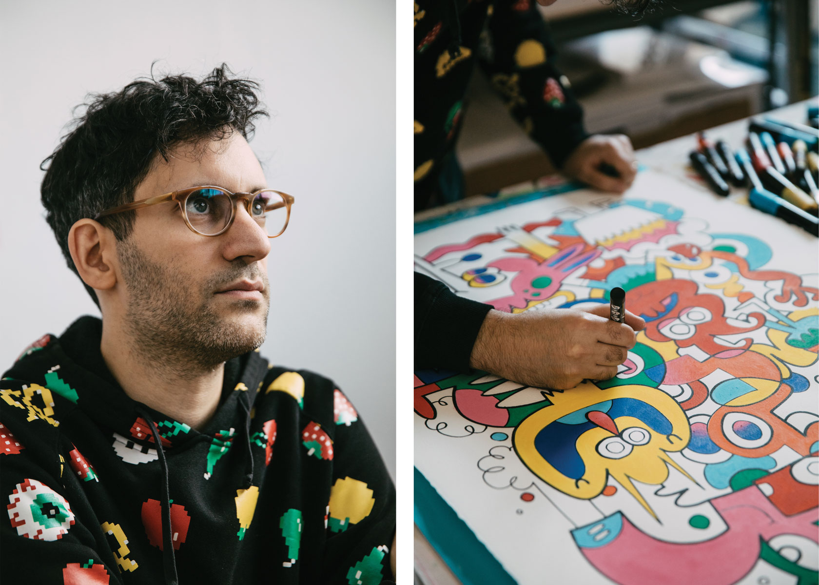 Burgerman dressed in an 8-bit style hoodie working on a colorful ink piece in his studio. Photographed by