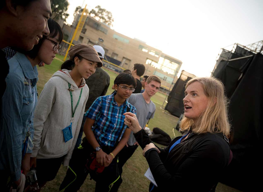 Vivienne Ming explains an idea to a group of seven students