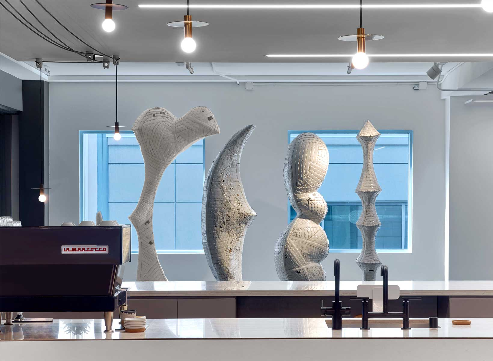 An office with four large sculptures